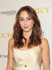 Troian Bellisario wore her hair down in a beachy wavy style at the premiere of 'Lucky.'