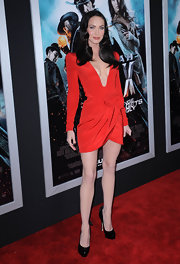 Megan showed off her lean legs in a super-short mini dress and sky-high patent Donna Pumps.