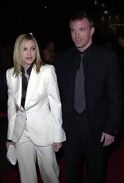 Madonna was striking in a white pant suit over a black blouse for the 'Snatch' premiere.