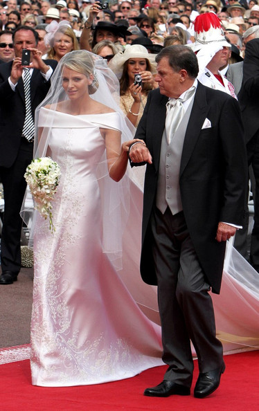 For the religious portion of her wedding, Charlene wore an elegant off-the-shoulder couture wedding dress with delicate flower embroidery.