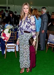 Olivia Palermo mixed patterns gracefully at the Sentabale Charity Polo Match where she wore this flowing purple floral blouse and smaller, delicate florals on her skirt.