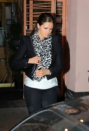 Princess Madeleine revealed a glimpse of her wild side with the animal print scarf that she wore as she dined with the queen.