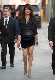Priyanka Chopra completed her outfit with pewter python pumps by Christian Louboutin.