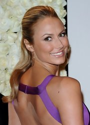 Stacy Keibler attended the QVC Red Carpet Cocktail Party wearing a pair of large flat magic hoop earrings in yellow gold with diamonds.