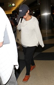 Rachel Bilson arrived on a flight at LAX wearing a baggy white sweater and black harem pants.