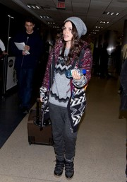 Rachel Bilson arrived at LAX looking cozy in an oversized Isabel Marant cardigan.