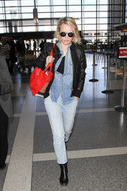 Rachel McAdams was tomboy-chic in a black leather jacket by Smythe while catching a flight at LAX.