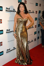 Lisa shimmered in a gold metallic dress while hitting the red carpet.