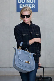 Rebecca Romijn looked stylish at LAX carrying a baby blue Kristin Woven Leather Sage Round Satchel.