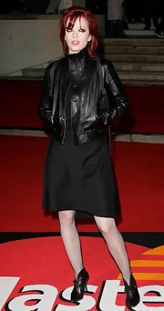 Shirley Manson added fishnet tights that showed off her signature rebel style.