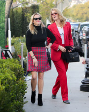 Reese Witherspoon's red plaid mini skirt from Draper James looked very Christmassy!