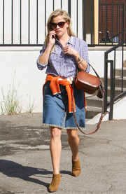 Reese Witherspoon paired her top with a cute denim skirt, also by Draper James.