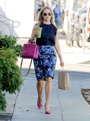 Reese Witherspoon walked the streets like she was sashaying down the catwalk in a lace-accented navy blouse from her own label Draper James.