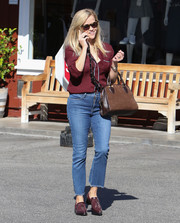 Reese Witherspoon was spotted out in LA wearing a maroon silk button-down by J.Crew.