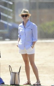 Reese stuck to her classic preppy style when she wore this blue gingham button down.