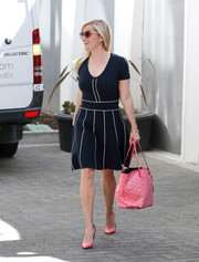 Reese Witherspoon was a cutie in a navy and white fit-and-flare dress by Draper James while headed to her office.