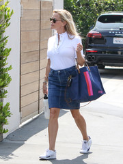 Reese Witherspoon was cute and youthful in a ruffled polo shirt by Draper James while out in LA.
