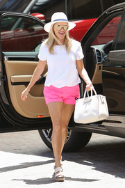 Reese Witherspoon sealed off her summery ensemble with cream-colored platform sandals by Tory Burch.