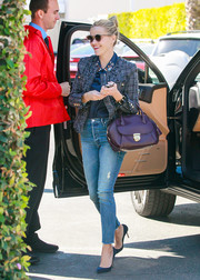 Reese Witherspoon had quite the arm candy with her purple bowler bag complete with gold hardware.