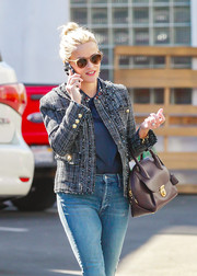 Reese Witherspoon wore her famous blonde locks in a top knot bun while out and about running errands.