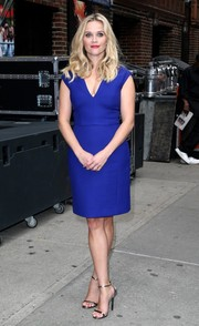 Reese Witherspoon polished off her look with chic silver ankle-strap sandals.