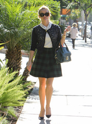 Reese Witherspoon finished off her chic and ladylike outfit with a green plaid mini skirt (also by Draper James).