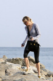 "Renee takes glamour to the beach by bringing her ""Kelly"" bag"