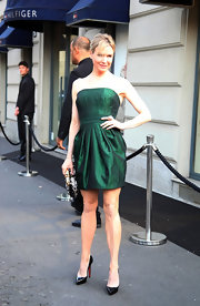 Renee shined in Milan wearing a strapless iridescent green cocktail dress.