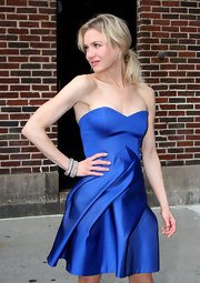 Renee creates contrast by keeping her hair casual with this amazing blue dress.