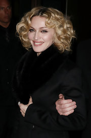 Madonna wears her shoulder-length hair in tight waves for the 'Revolver' premiere.