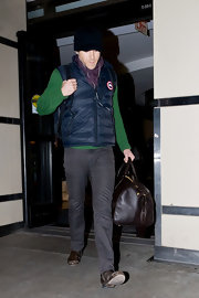 Ryan wears gray slacks with a colorful outfit to the airport.