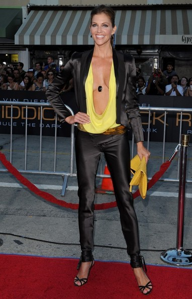 Tricia paired a black satin blazer over a dramatic plunging top.