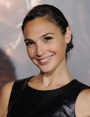 Gal's braided updo gave her a sweet and feminine look that contrasted her bold leather top!