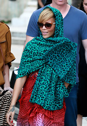While traveling through Jerusalem Rihanna paired her Cateye shades with a leopard print scarf.