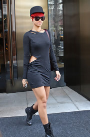 The ever stylish Rihanna stepped out in a cutout gray dress with a matching military cap.