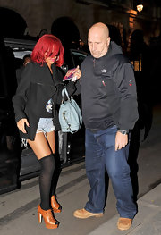 Leave it to Rihanna to put her own twist on a pair of cognac ankle boots. School girl style knee-highs and distressed cut-off shorts make this look oh so Rihanna.