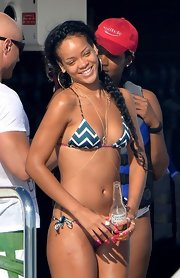 Rihanna wore her long hair in braided pigtails for her boating in France.