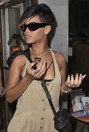 "It doesn't matter what time of day it is - Rihanna's going to have her ""6000 Series"" black framed shades."