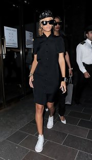 Rihanna's black button-down shirt dress looked cool and simple on the pop star.