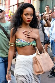Rihanna looks like a boho beauty with messy beach waves.