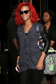 Adding a retro flair to her casual look, Rihanna showed off a classic pair of wayfarer shades.