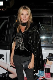 Kate Moss looked dramatic in a studded black velvet cape at the Rimmel London 180 Years of Cool party.