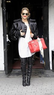 Rita's style can be be described as funky. Just look at these over-the-knee boots and oversize jacket!