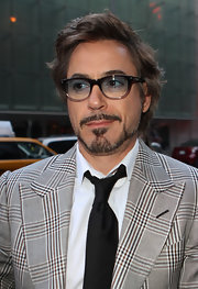 Robert looked geek-chic in a plaid suit with classic wayfarers featuring a slight blue gradience.