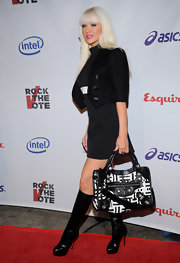"While walking the red carpet at the Rock The Vote event, Christina donned a coveted ""City Bag"". which featured a rare black and white print."