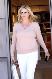 Penny Lancaster was spotted in Beverly Hills wearing a simple ensemble featuring a V-neck sweater.