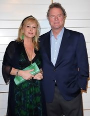 Kathy Hilton's green snakeskin clutch was a bright addition to her ensemble at the Walk of Style Award.