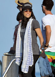 Michelle Rodriguez accessorized with a patterned scarf while partying on a yacht in Saint Tropez.