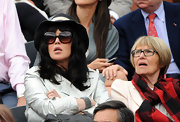 Isabelle Adjani watched the 2010 French Open Men's Final behind a pair of super-stylish square sunglasses.