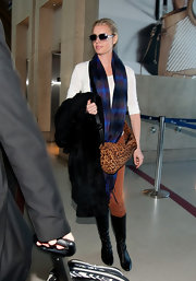 Rebecca Romign added to the eclectic vibe of her travel attire with a leopard print satchel and a plaid scarf.